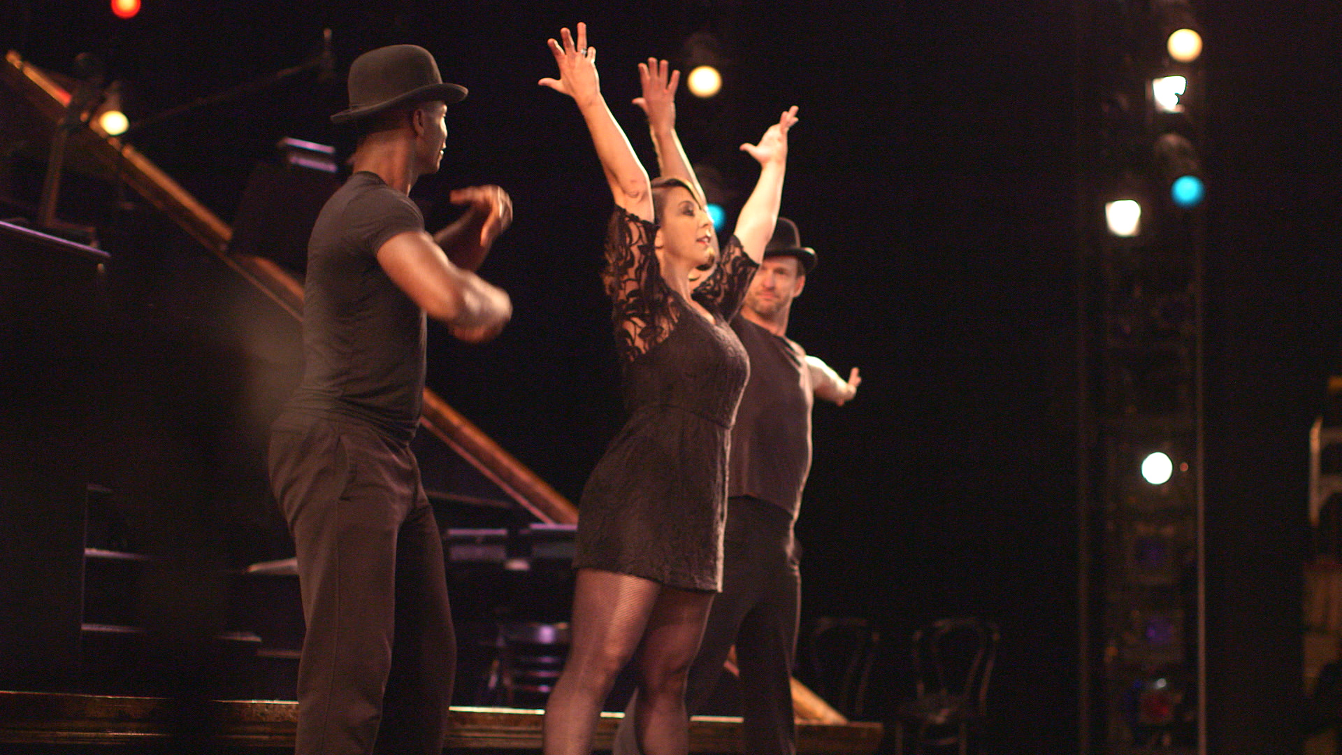 Mickela jumps on stage with cast member of CHICAGO The Musical.