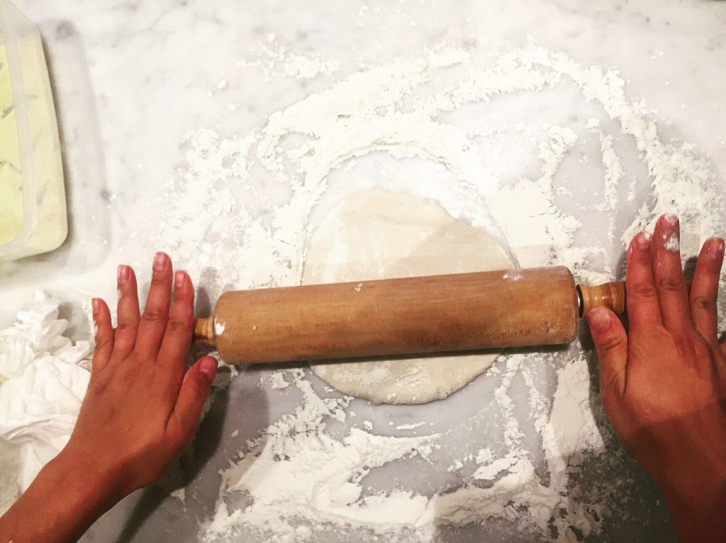 I'm attempting to make my own dough but in the meantime I highly suggest Whole Foods fresh pizza dough. Leave it out to proof an hour before you roll them out while the oven is warming up to temperature. I cook my pizzas at 500-515 and let my stone heat up for a good hour before cooking.