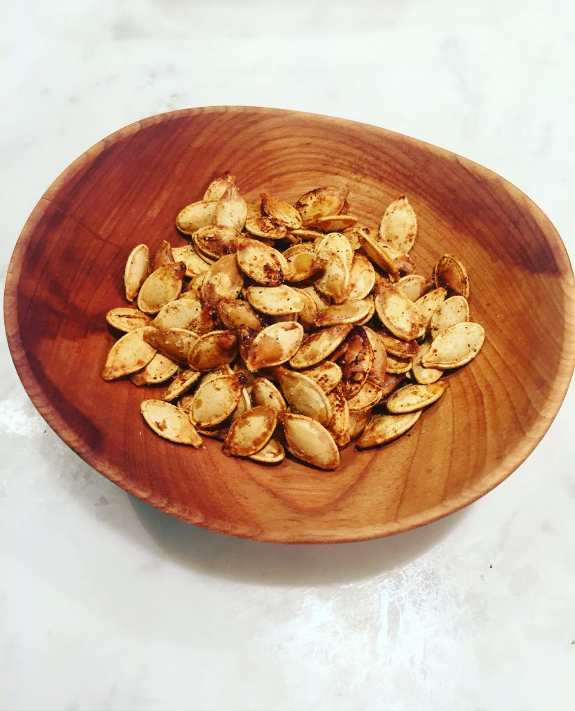 After we scooped and carved out pumpkins I quickly roasted and seasoned the seeds. Love using these for salads and snacking!