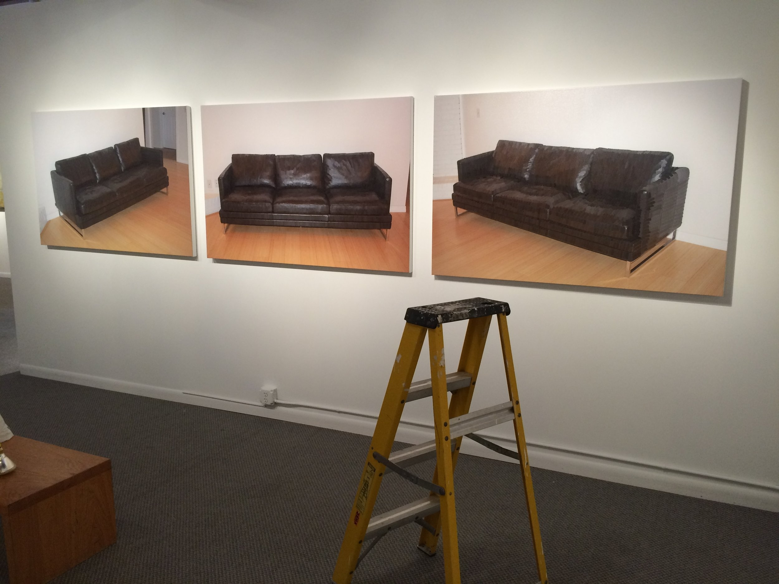 Painted Black Couches on the wall.JPG