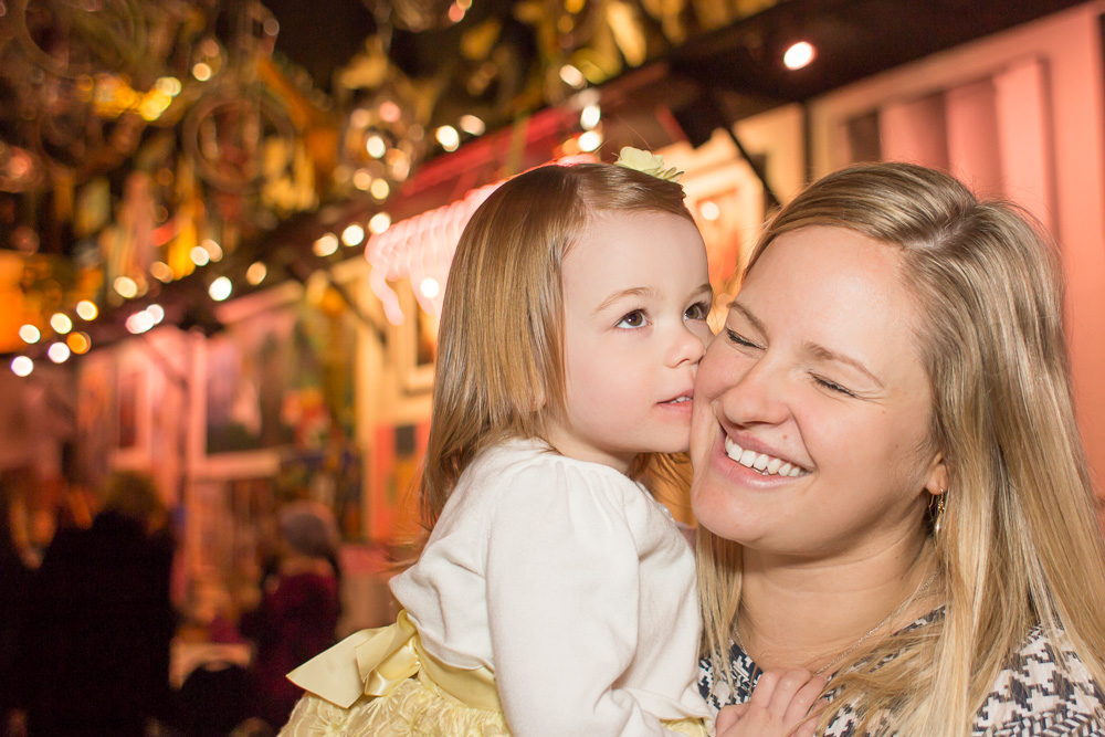 Candid photo of bride and flower girl at bridal shower | Artisan Works in Rochester, NY