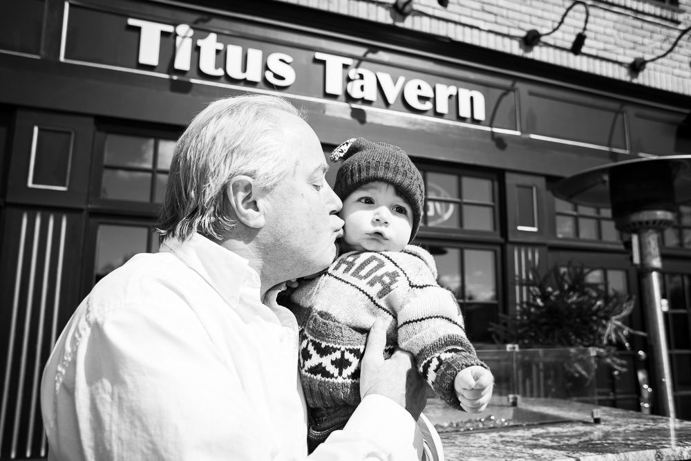 Grandpa and grandson outside the family bar