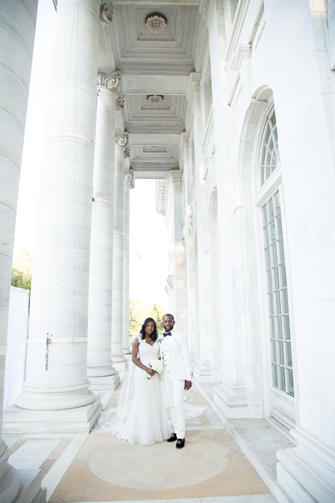 Bride and groom posing for a classic DC portrait with the white columns at DAR