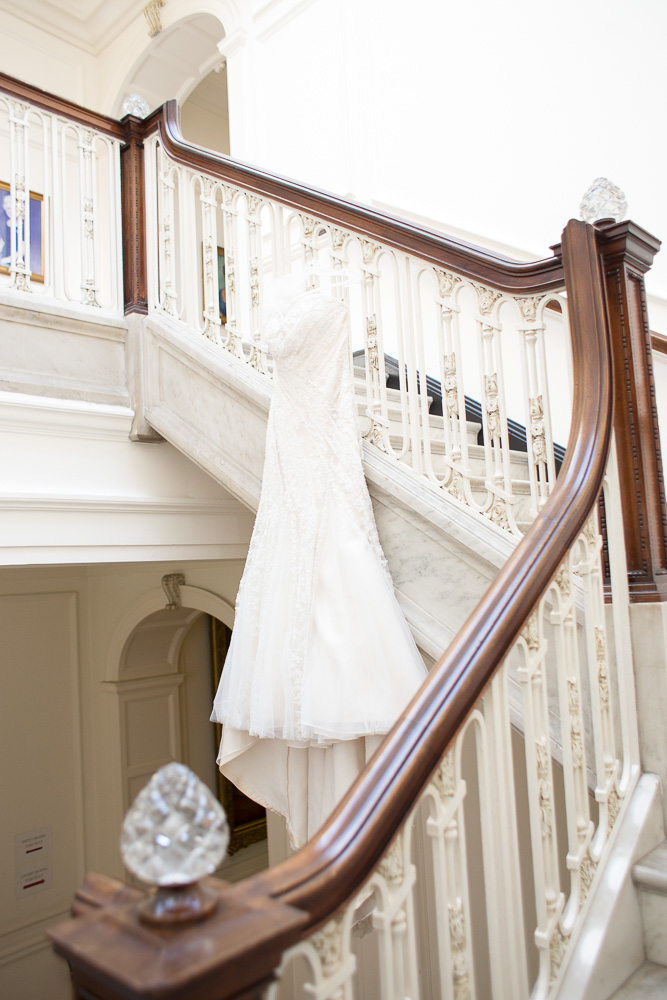 The wedding dress hanging in the staircase of DAR Constitution Hall | Classic DC Wedding Photography | Megan Rei Photography