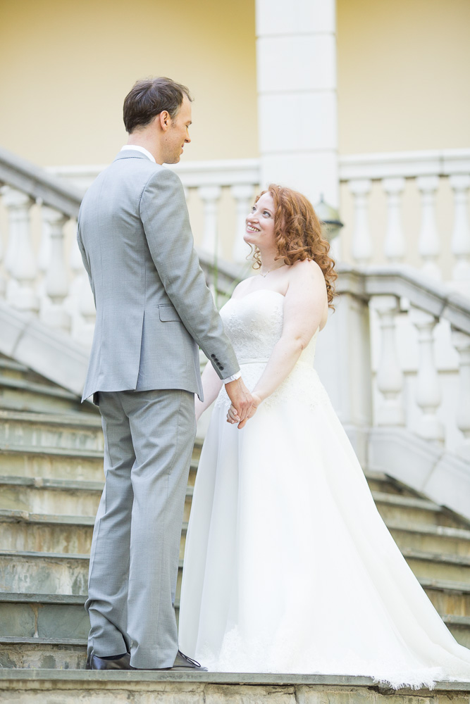 Bride and groom wedding photo on the staircase at Airlie   Megan Rei Photography   Northern Virginia Weddings