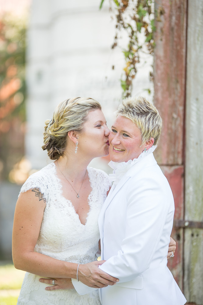 Sweet kiss during wedding photos at Linganore Winecellars in Mt. Airy, Maryland