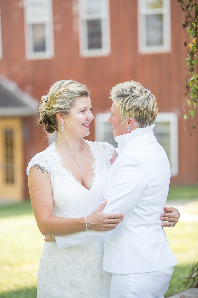 Two brides looking at each other on their wedding day in Maryland | DC gay wedding photographer DC