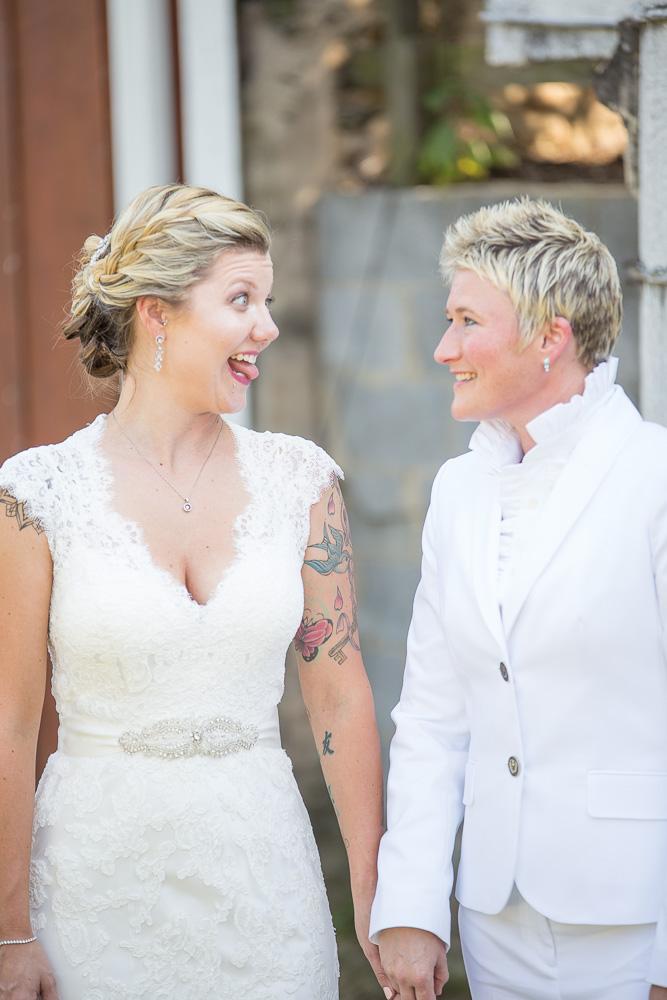 Candid photo of wedding couple having fun on their wedding day