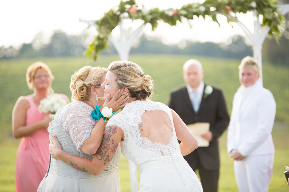 A sweet mother and bride moment during the wedding ceremony | Linganore Winecellars Wedding | Maryland Wedding Photographer | LGBT Wedding Photography
