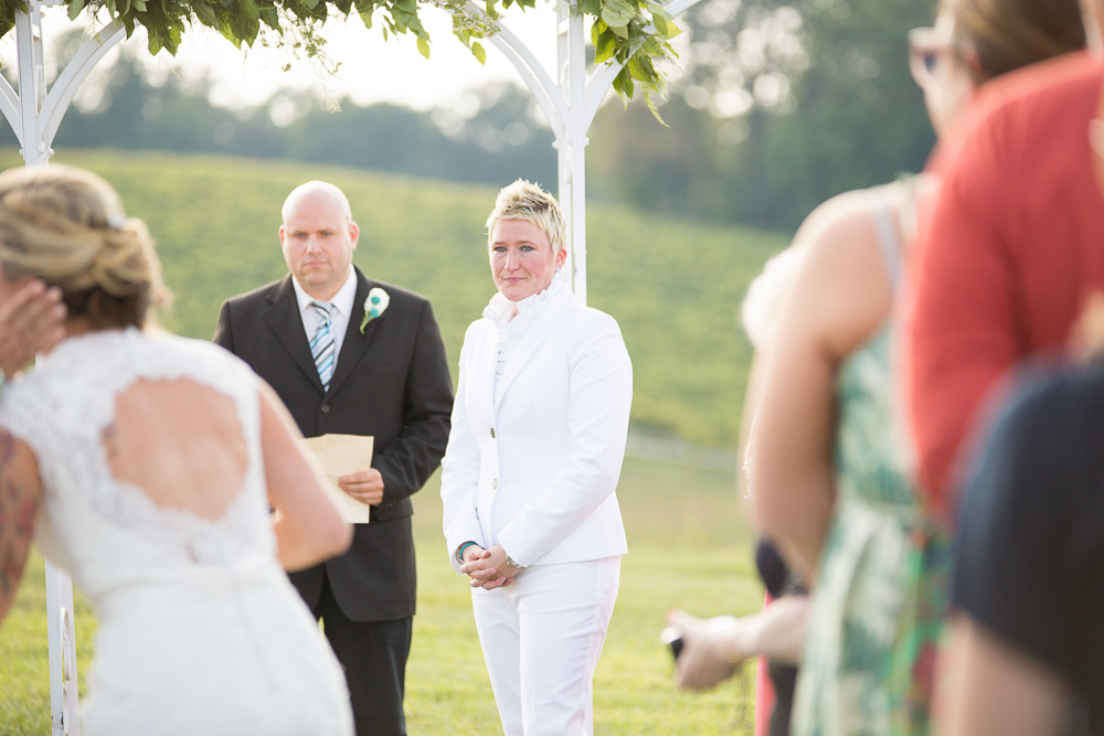 Bride watching the bride come down the aisle during wedding ceremony at Linganore Winecellars