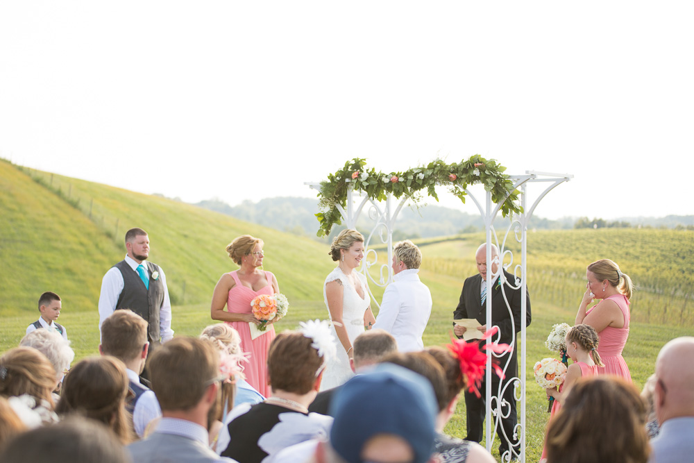 Same-sex wedding ceremony at Linganore Winecellars with view of the vineyard