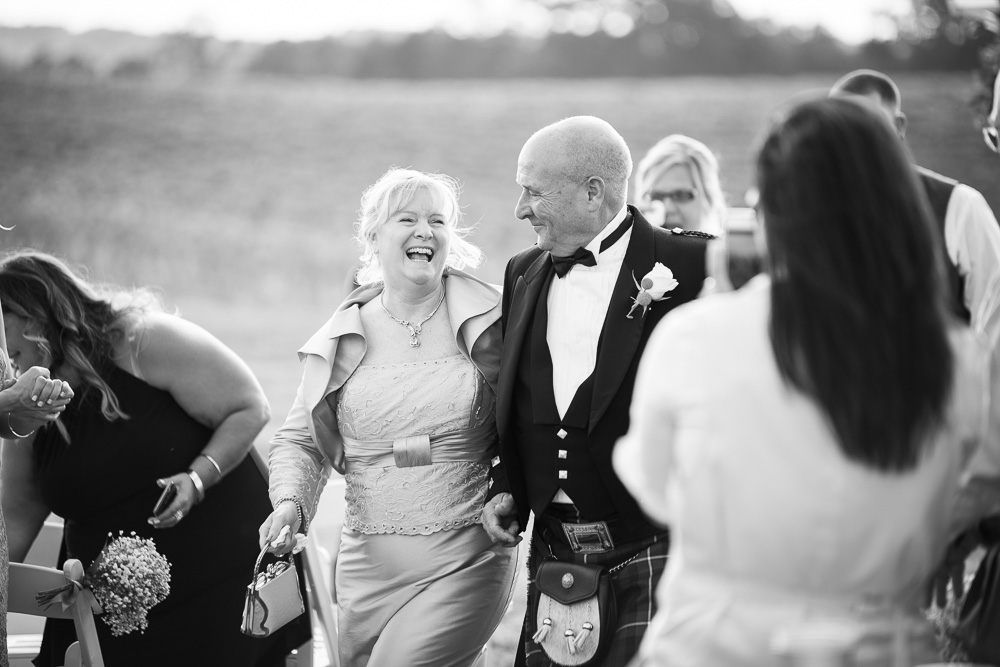 Parents walking up the aisle after the wedding