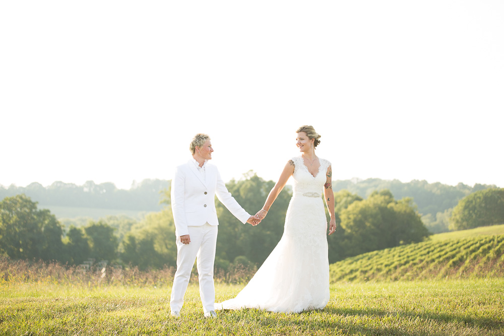 Happy wedding couple with Linganore Winecellars vineyard in the background | Lesbian wedding photography DC