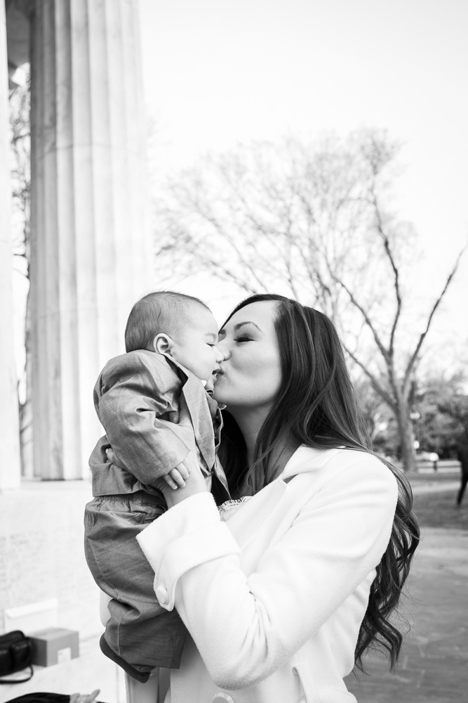 Adorable wedding day photo of bride and her son at the DC War Memorial | Megan Rei Photography | Photojournalistic wedding photography