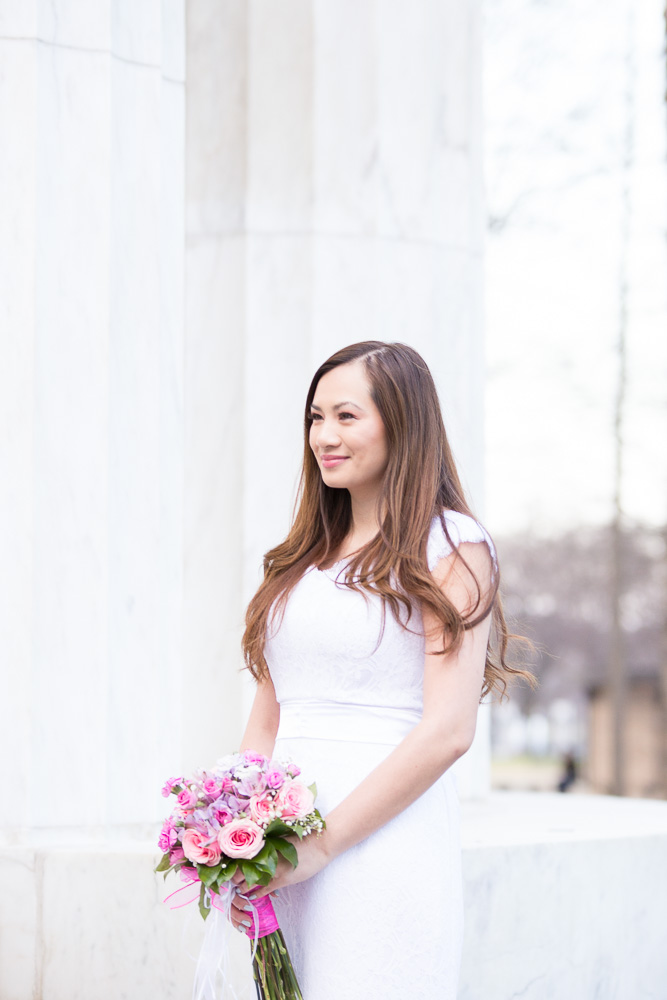 Stunning bride with her bouquet from Twin Towers Florist | DC War Memorial Wedding | Megan Rei Photography