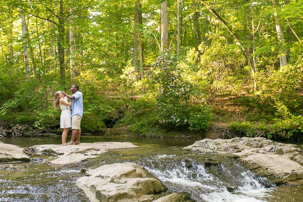 Fun engagement photos hiking in the forest| Candid wedding photography in Northern Virginia | Quantico Falls Trail