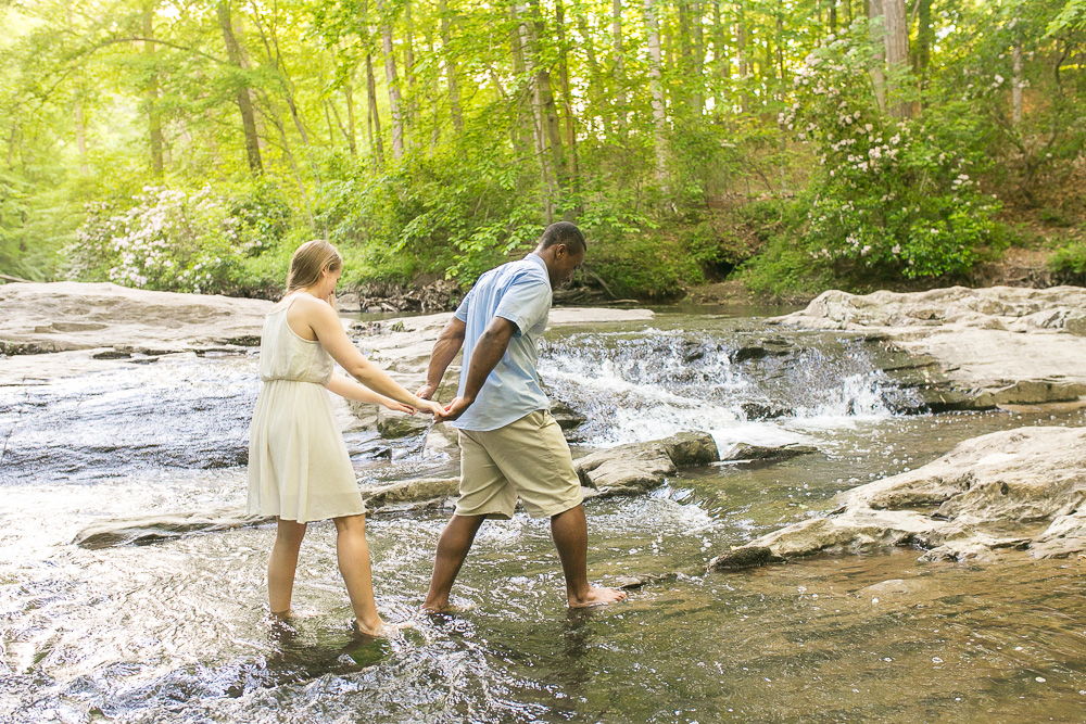 Hiking carefully through the water | Outdoor engagement photography in Northern Virginia | Megan Rei Photography