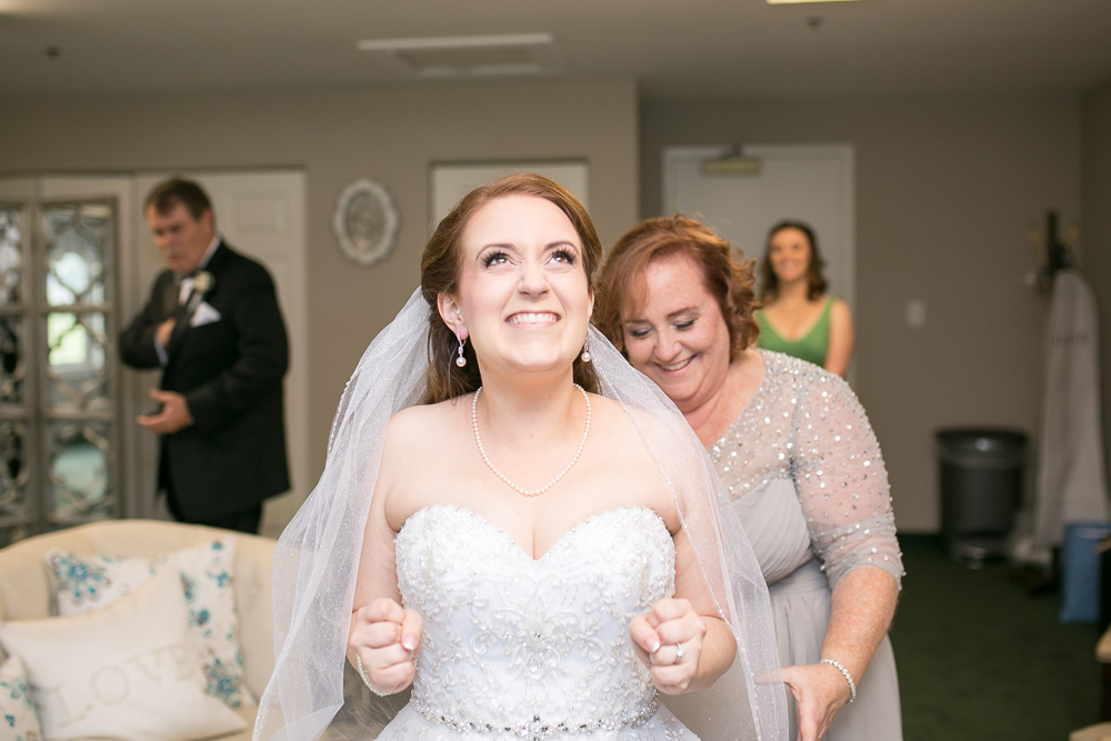 Happy bride on her wedding day | Evergreen Country Club | Megan Rei Photography
