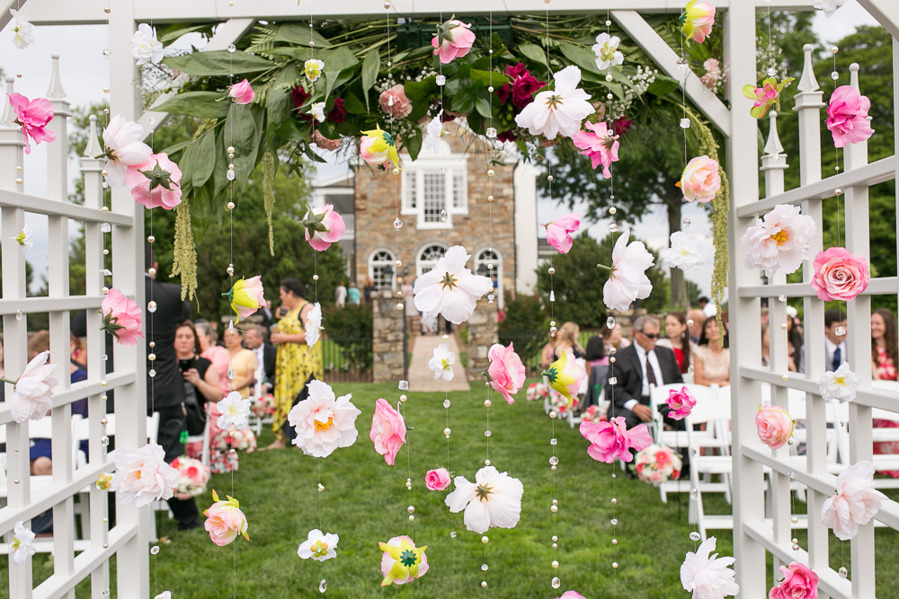 DIY flower curtain | Hanging floral backdrop for outdoor ceremony at Evergreen Country Club | Northern Virginia Wedding Photographer
