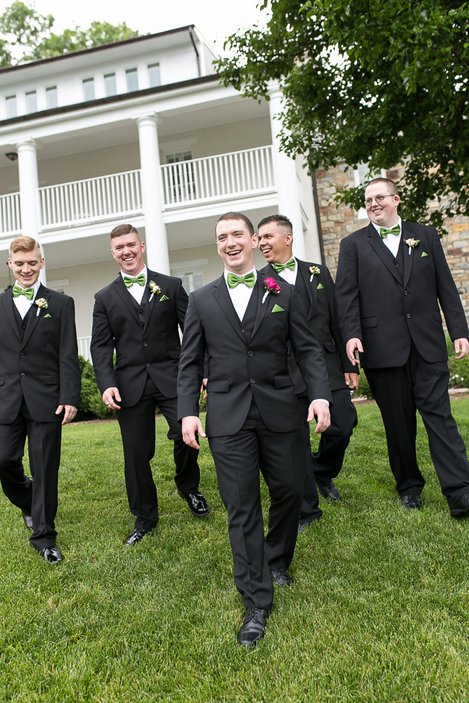 Groomsmen in front of the Inn at Evergreen | Candid wedding photography in Northern Virginia