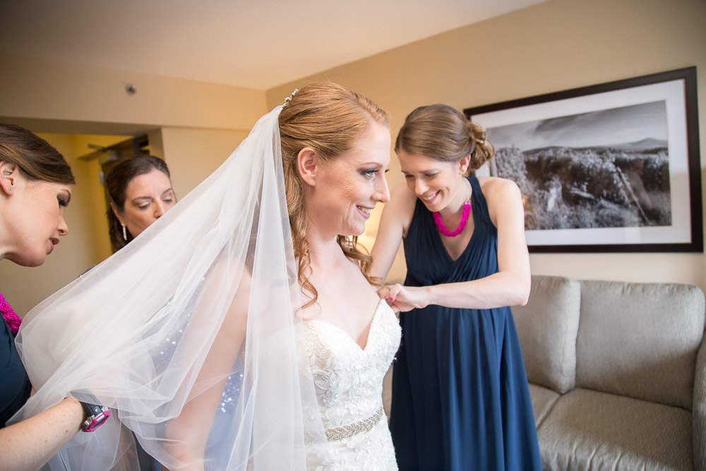 Bride putting on her wedding dress | Photojournalistic wedding photography in Rochester, NY | Megan Rei Photography