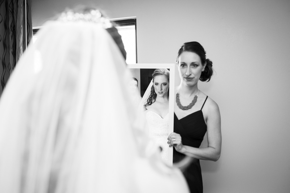 Bride looking in the mirror while getting ready for the wedding day | Documentary Rochester Wedding Photography