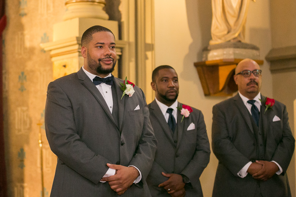 Groom watching his bride come down the aisle | Photojournalistic Wedding Photography in Rochester, NY