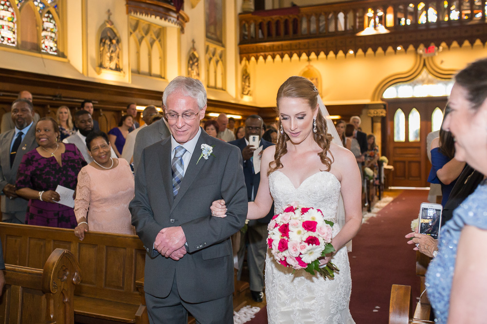 Bride and her father walking down the aisle | Chapel Hill Wedding Venue in Rochester