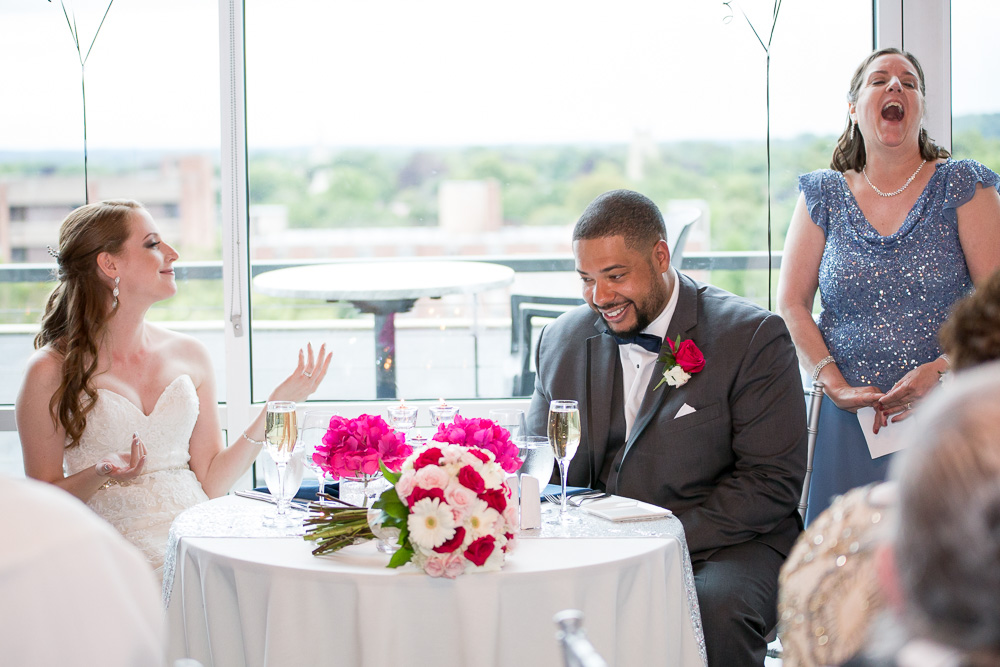 Laughter during wedding toasts | Photojournalism style of wedding photography | Best Wedding Photographers in Rochester, NY