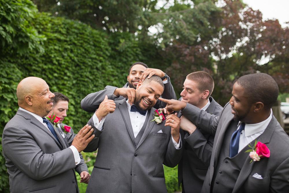Groom and groomsmen goofing around after the wedding | George Eastman Wedding Photos