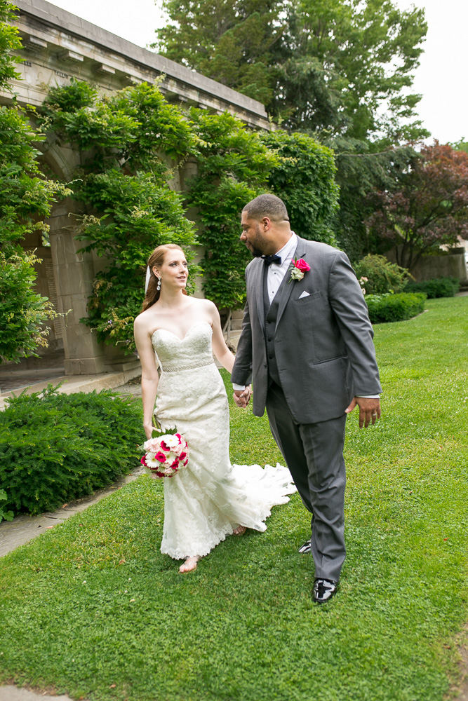 Bride and groom walking through the George Eastman Gardens | Best Rochester Wedding Photography | Megan Rei Photography