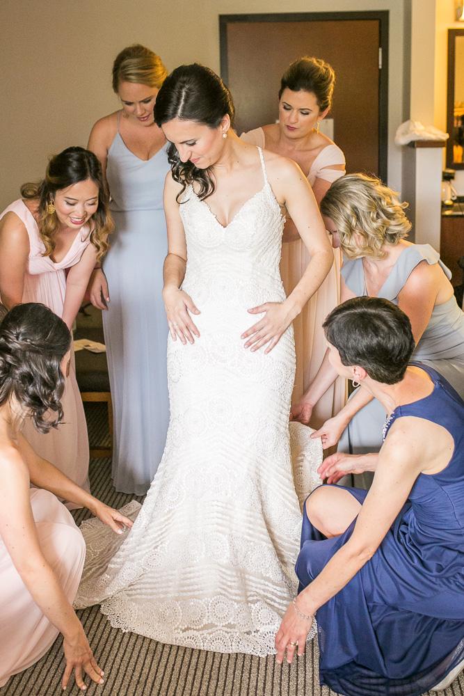 Helping the bride put on her wedding dress | Northern Virginia Winery Wedding | Documentary Style Photographer in Washington, DC