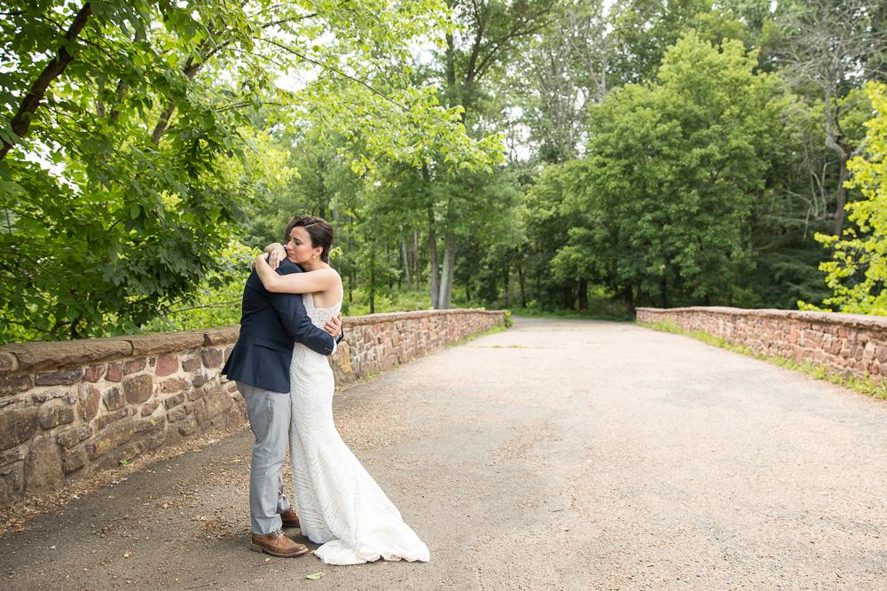 Candid moment between bride and groom on the Stone Bridge at Manassas National Battlefield | Manassas, VA Wedding Photos | Megan Rei Photography