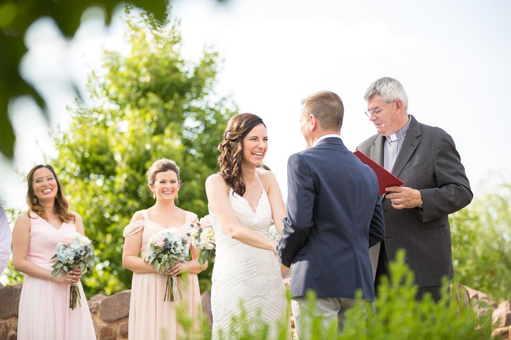 Smiling bride during a sunny wedding at Bull Run Winery | Manassas, Virginia Wedding Photographer