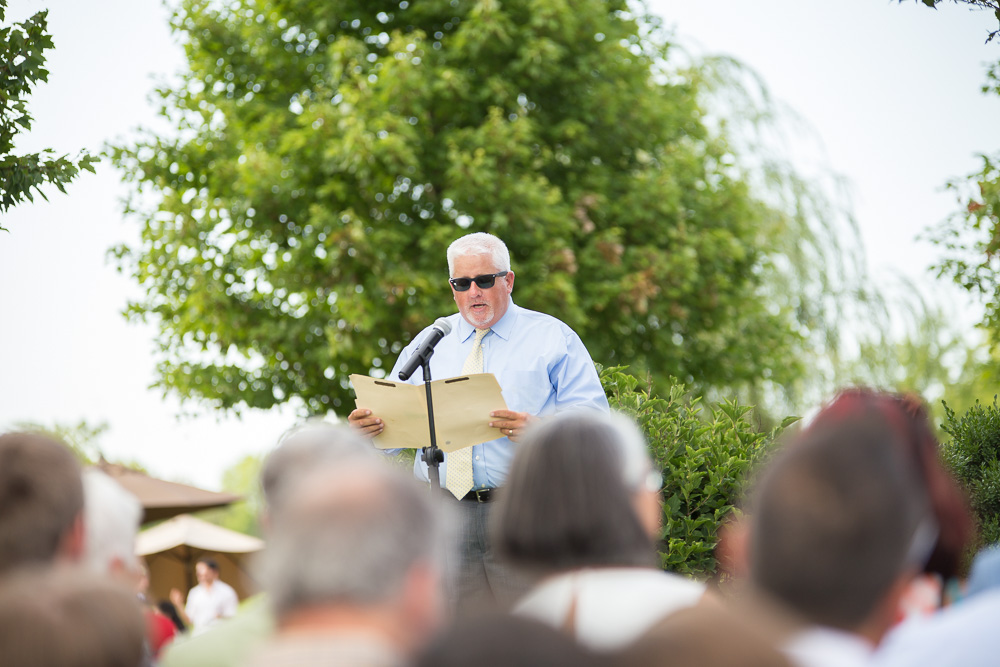 Wedding ceremony reading during a summer wedding at The Winery at Bull Run | Centreville, VA