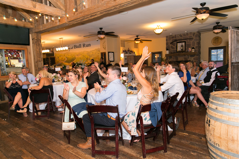 Guests laughing during the wedding toasts | Fairfax documentary wedding photographer