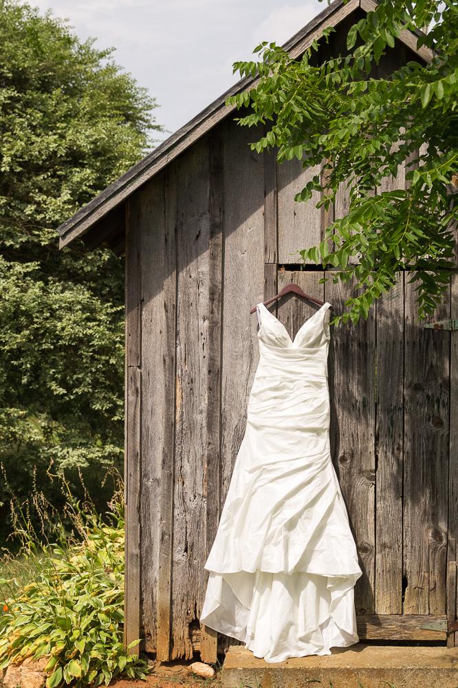 Wedding dress hanging from the barn at Mountain Run Winery in Culpeper, VA