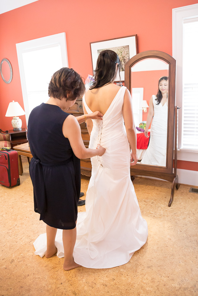 Bride putting on her dress | Virginia Wedding Photography