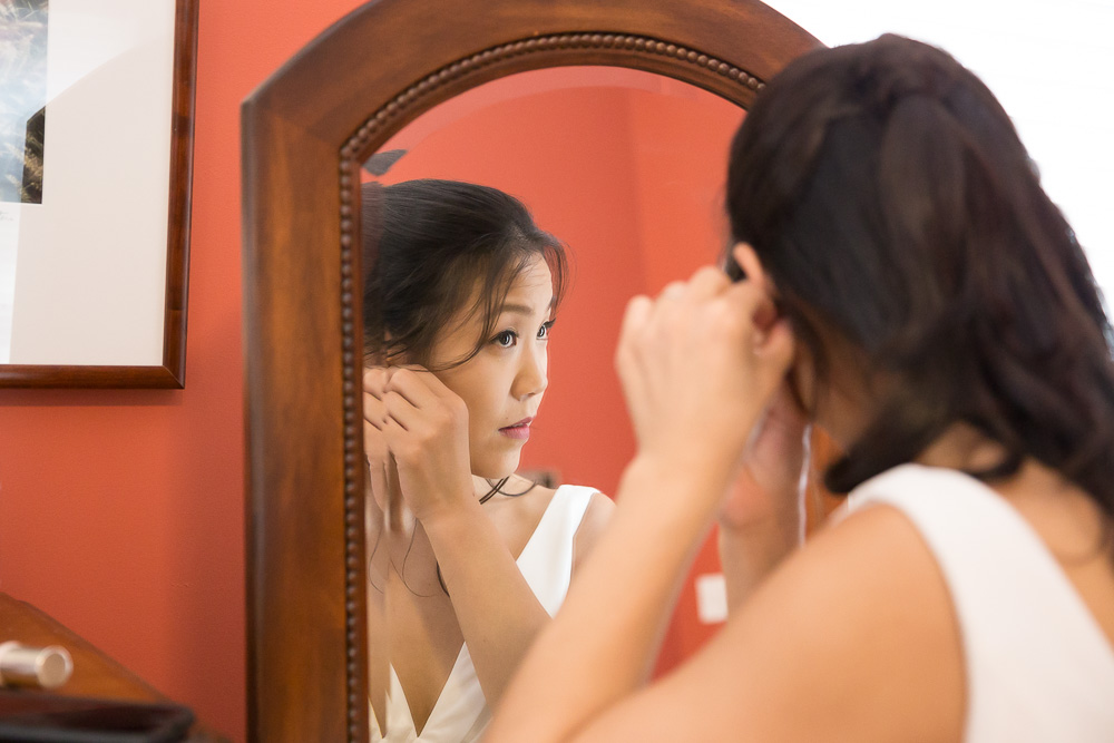 Bride putting in her earrings | Wedding day prep