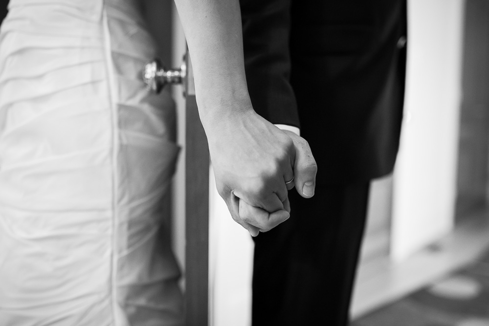 Bride and groom holding hands before the ceremony | Winery Wedding in Northern Virginia