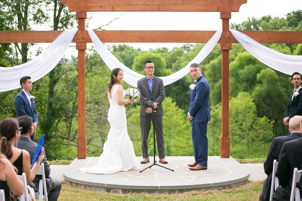 Watching those storm clouds! Luckily the rain waited until after the ceremony | Candid Photographer in Northern Virginia