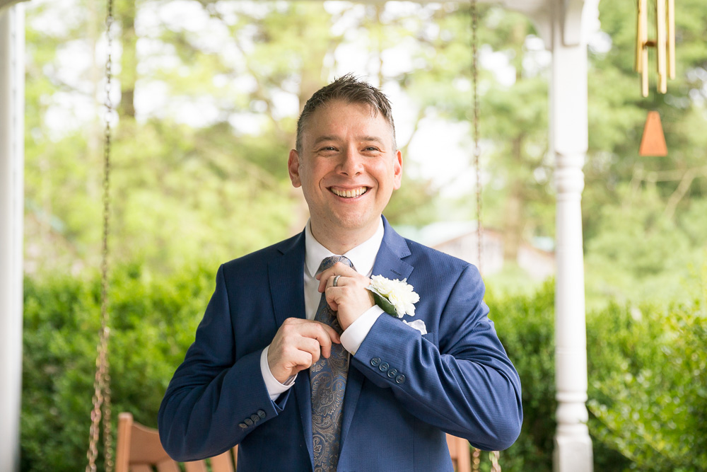 Groom straightening his tie | Virginia Wedding Photography