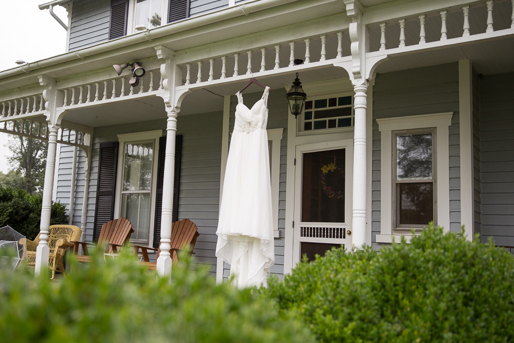 Wedding dress hanging from the farmhouse at Mountain Run Winery