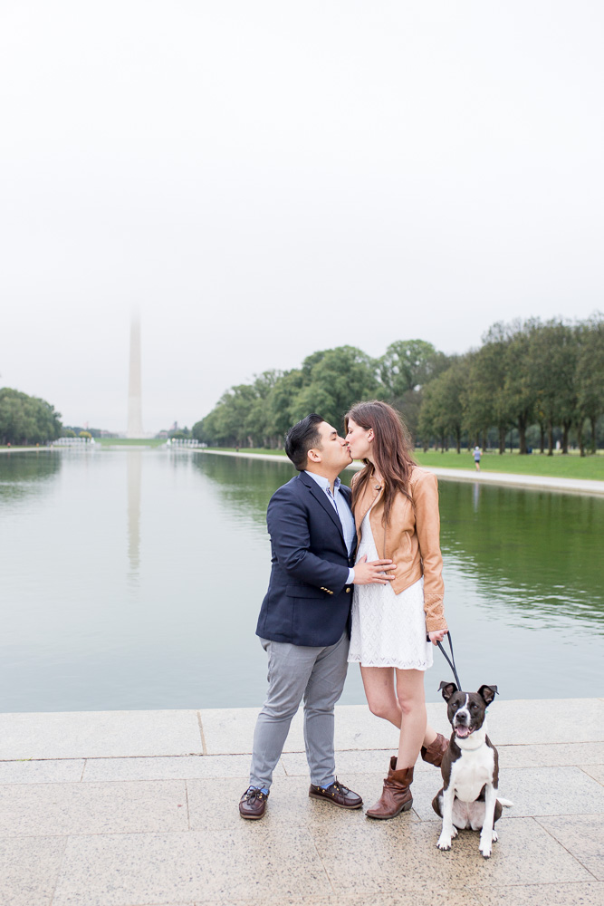 Engaged couple with their dog in front of the Reflecting Pool | DC monuments engagement session | Washington DC Wedding Photographer