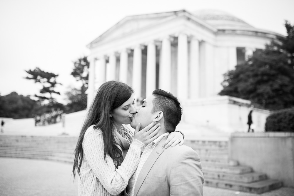 Romantic kiss at the Jefferson Memorial during engagement photo shoot | Classic DC Engagement Photography Locations