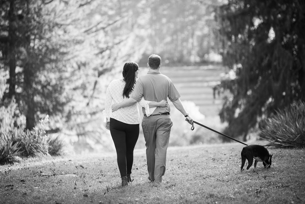 Engaged couple taking a walk at Blandy Experimental Farm
