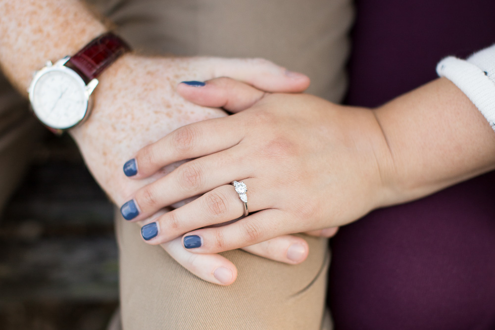 Holding hands during engagement shoot