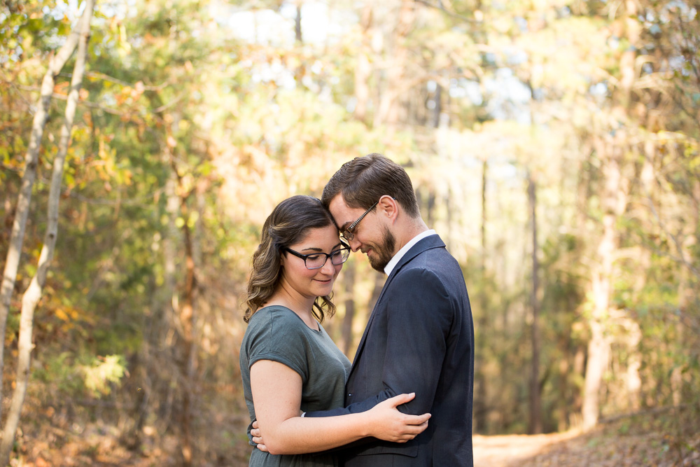 Sweet engaged couple on a trail in Crockett Park, Midland