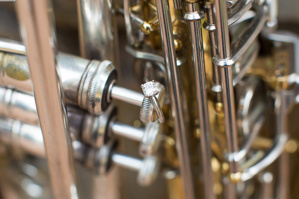 Engagement ring on trumpet during musical engagement photo shoot in Warrenton, Virginia