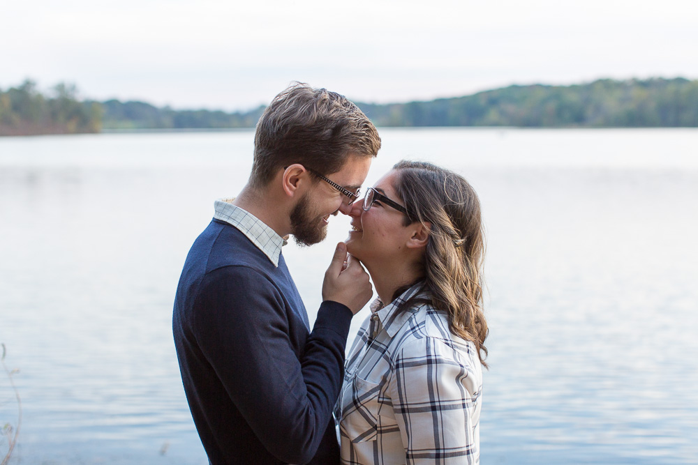 Sweet engagement photo of couple about to kiss near Germantown Lake, Virginia